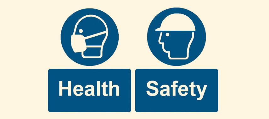 Health and safety awareness, man wearing a hard hat and a man wearing a protective mask